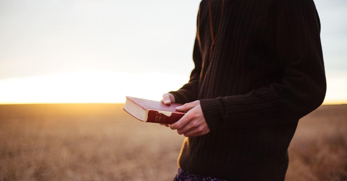 72233-person-holding-bible-priscilla-du-preez-unspl.1200w.tn.jpg